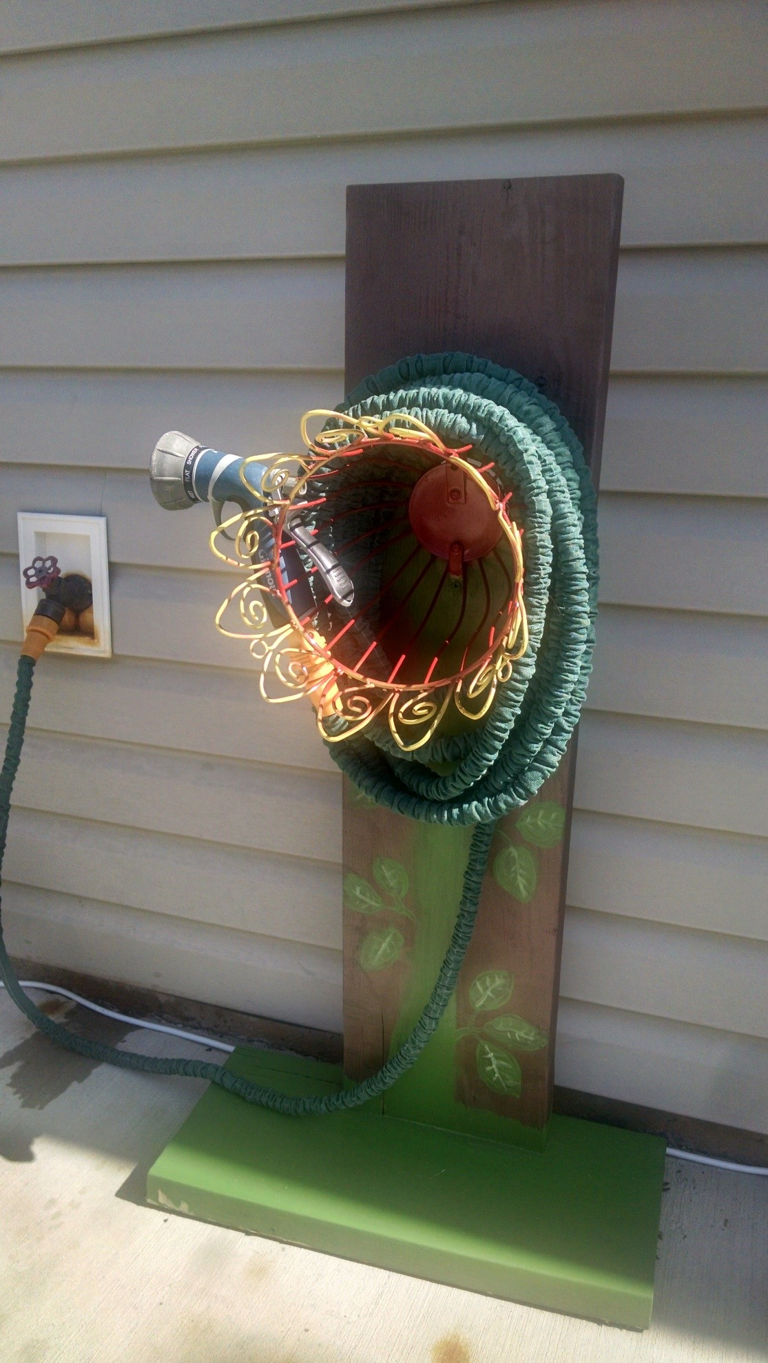 Build your own garden hose hanger goodwill southern for Diy garden hose storage