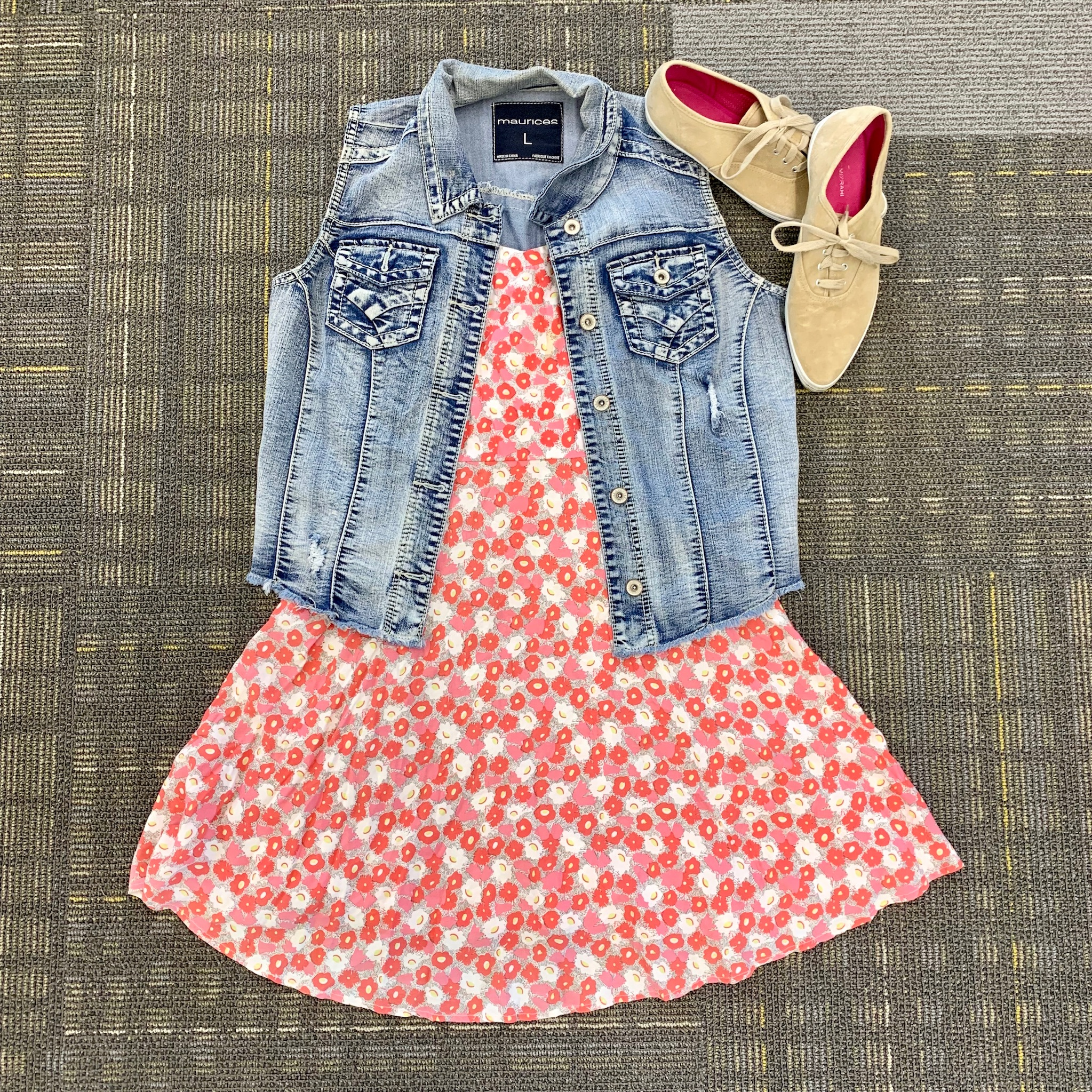 denim vest over pink and coral floral dress with tan suede sneakers