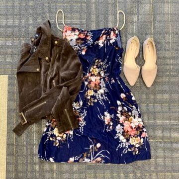 Blue floral dress with brown moto jacket and suede flats