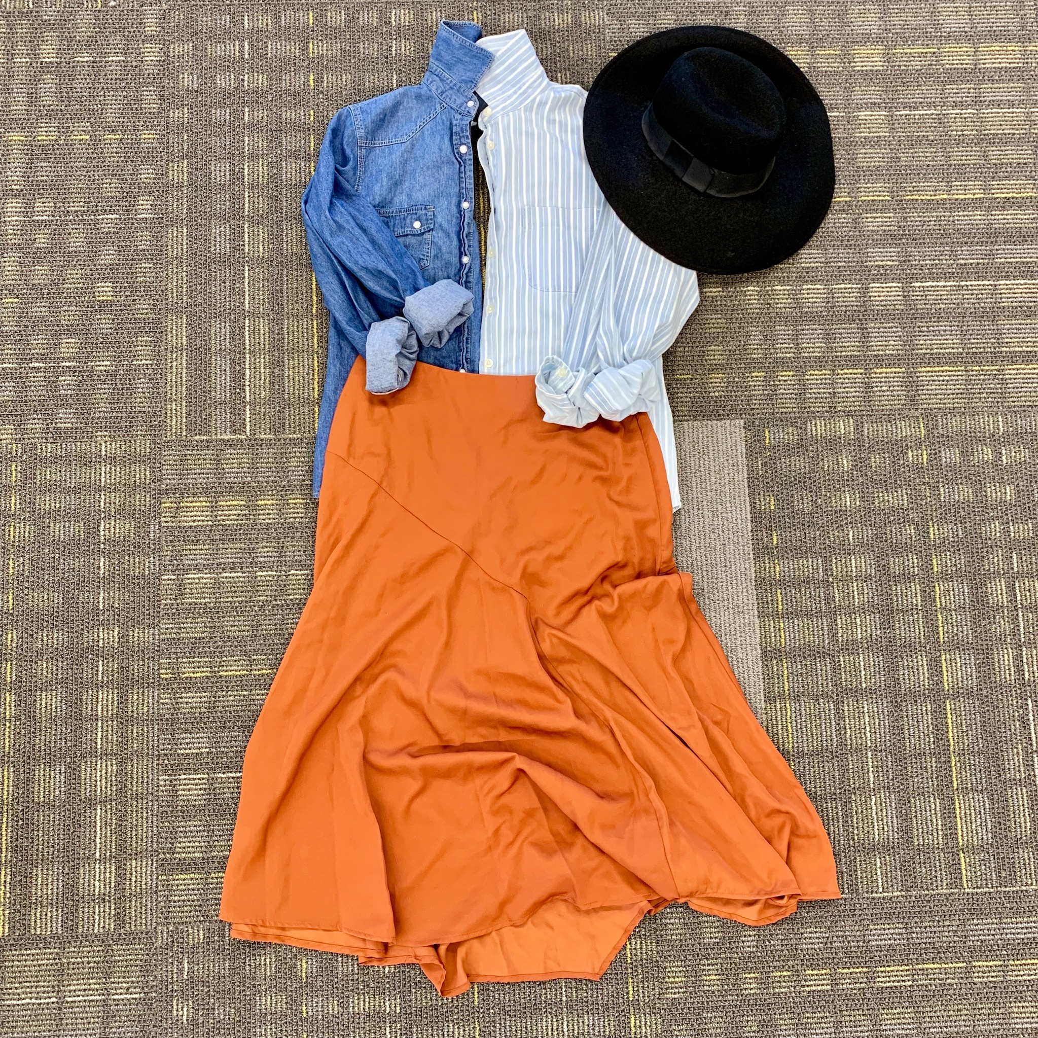 rust skirt with chambray button-downs and felt wide-brim hat