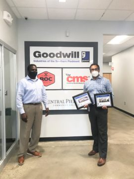 HEFL presents Goodwill with two awards for supporting construction projects with quality talent