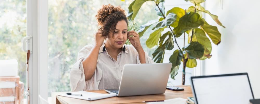 Adult woman taking online workshops