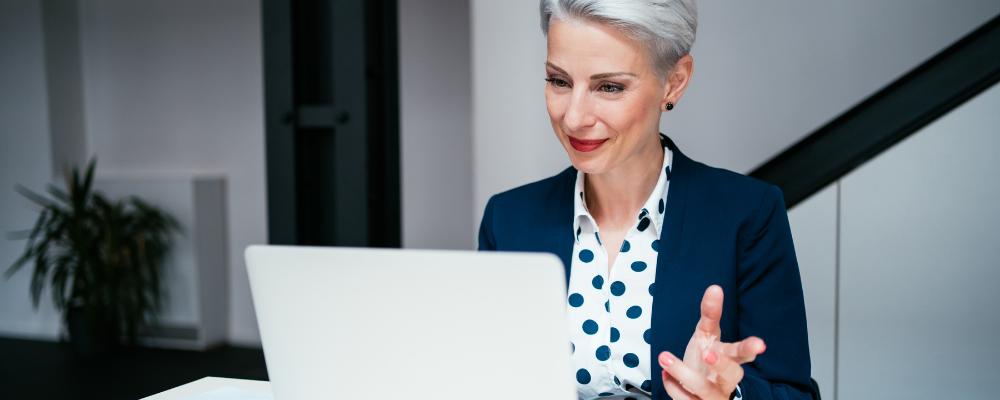 Older woman take Microsoft training course