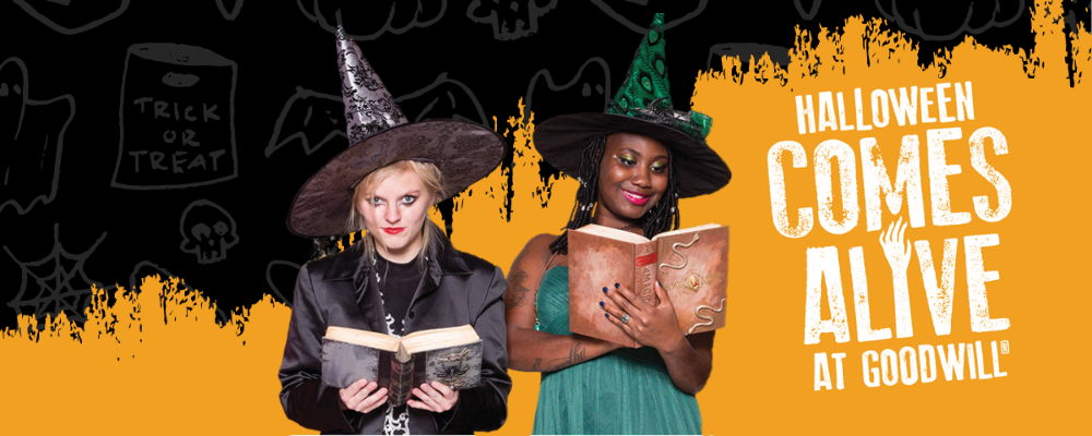 Two women dressed as witches for Halloween